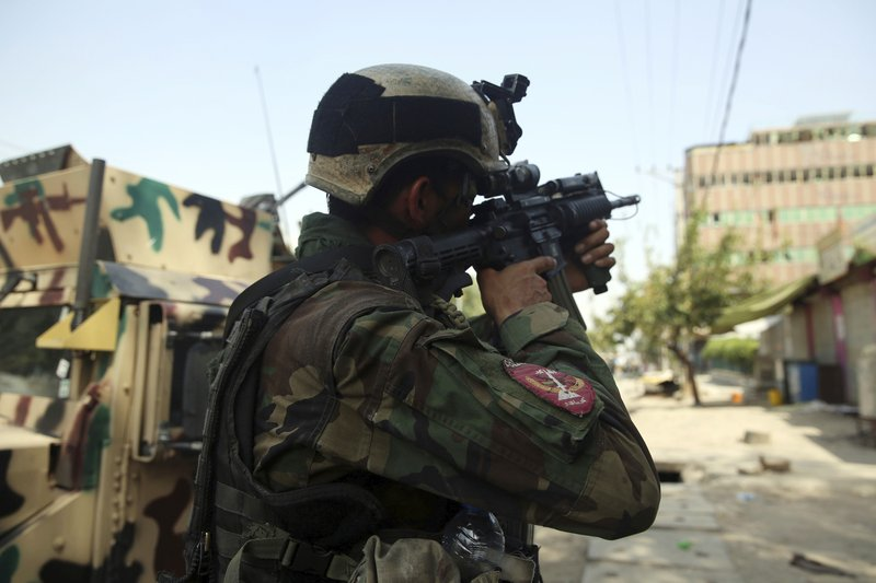Afghan troops retake prison attacked by IS group; 29 killed
