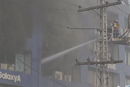 Horrific blaze engulfs over 300 shops at Lahore's Hafeez Center as cooling process underway