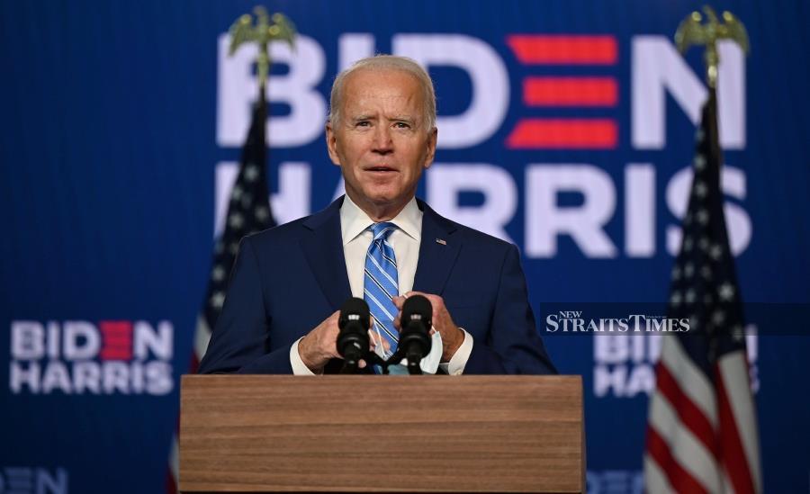 Biden pledges to rejoin Paris agreement as US formally withdraws