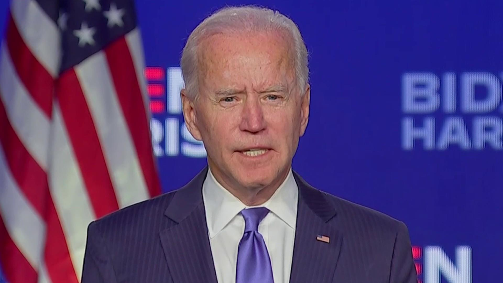 Confident in victory, Biden appeals for national unity
