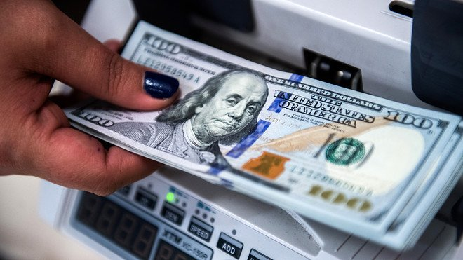 US dollar slides to lowest level in almost 6 months