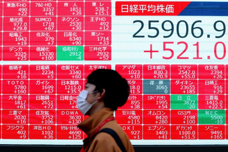 Asian markets swing as traders mull virus, vaccines and stimulus