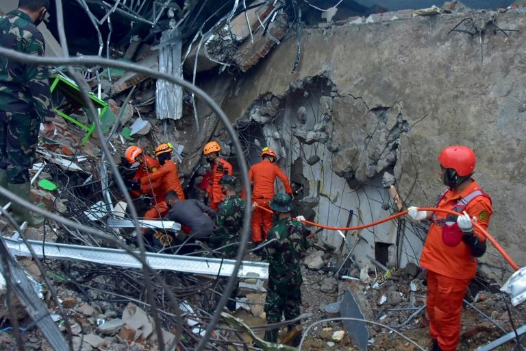 Hunt for buried survivors after Indonesia quake