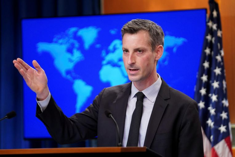 US warns China on force at sea, again rejects claims