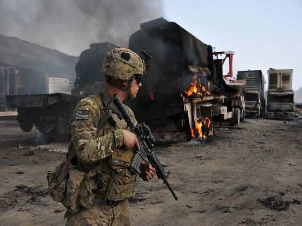 Afghan forces fight to recapture Taliban-held district outside Kabul