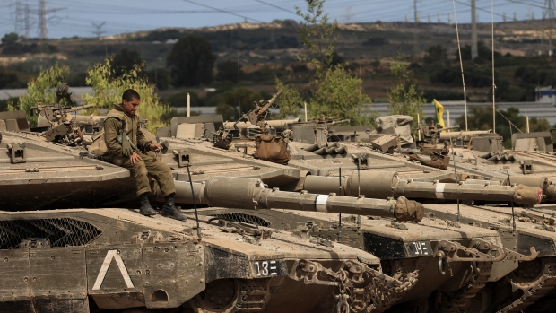 Hamas fighters display weapons in Gaza after truce with Israel