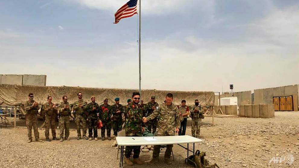 Taliban, Afghan forces clash as US hands over base