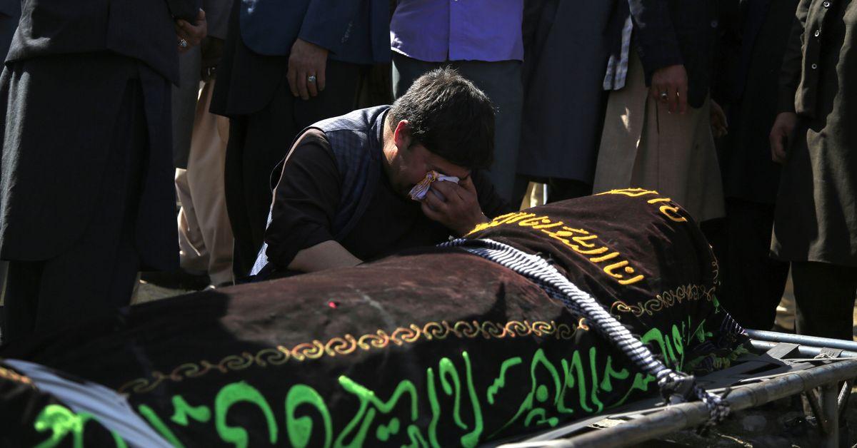 Afghanistan mourns 60 schoolgirls killed in deadliest attack in years