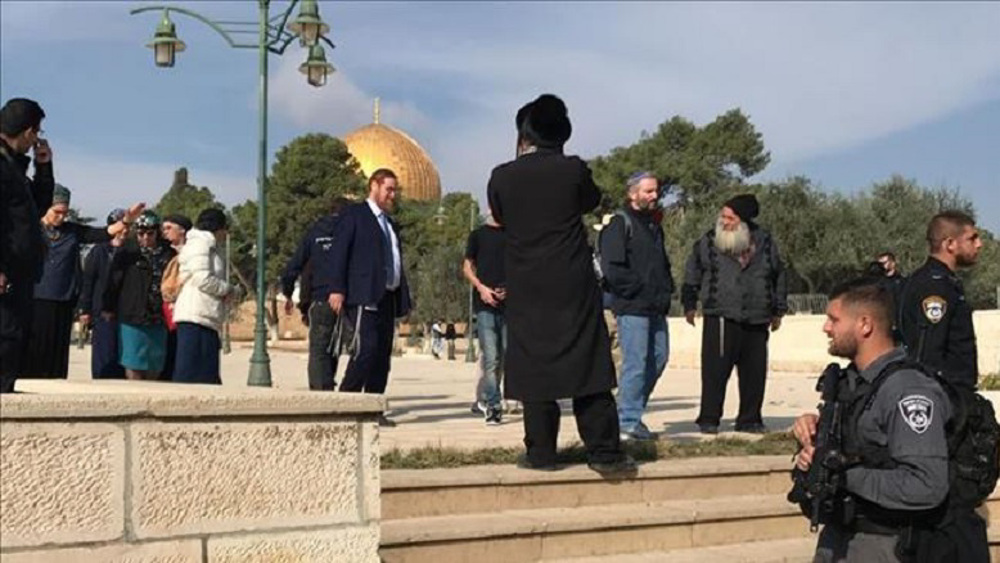 Hours into ceasefire deal, Israeli police storm Al Aqsa compound once more