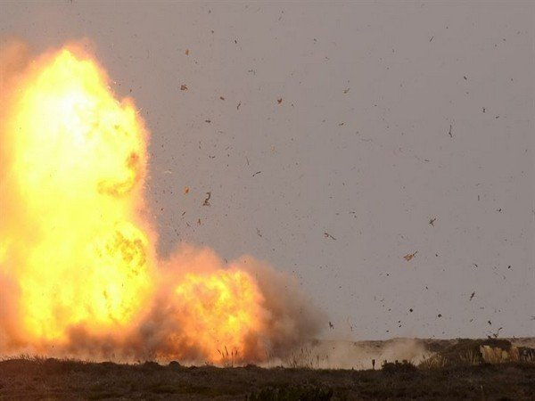 Afghan hospital burns after attack; Taliban seize border post in north